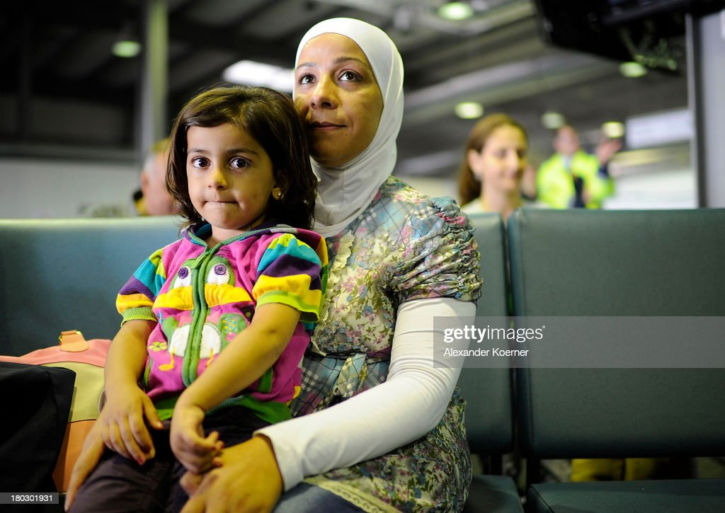 Syrian Refugees sit in the arrival hall after arriving at Hanover Airport on September 11, 2013 in Hanover, Germany. More than 100 Syrian refugees arrived in Hanover from refugee camps in Lebanon today, as part of a resettlement program which will allow them to stay in Germany for two years. They are the first group of refugees who have been offered asylum in Germany after being deemed vulnerable by the United Nations High Commissioner for Refugees, having escaped the ongoing conflict in Syria.