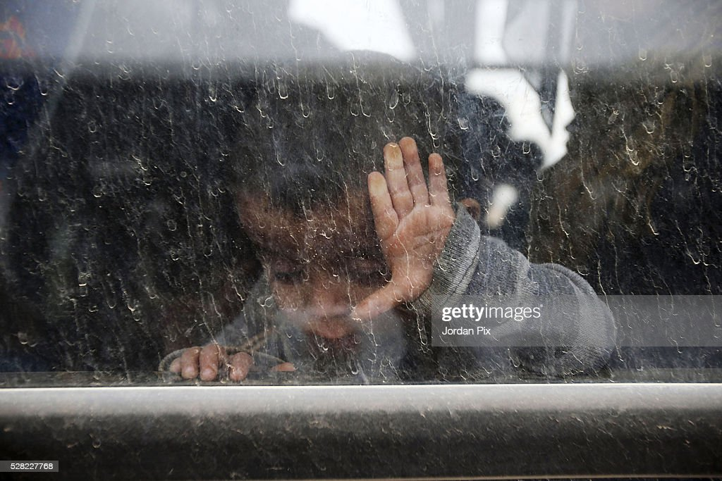 A Syrian refugees sits on a bus headed to a camp at the Jordanian military crossing point of Hadalat at the border with Syria on May 4, 2016 in Hadalat, Jordan. Coming from the cities of Raqaa, Deir Al-Zor and Hama, roughly 300 hundred refugees crossed into Jordan at Hadalat on Wednesday, while over 5000 refugees crossed in the last four days coming from Aleppo.