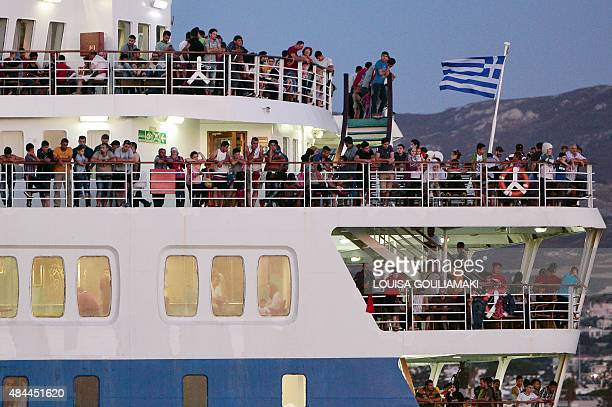 Syrian refugees stand aboard the Eleftherios Venizelos liner which will serve for their registration and as housing facility for some migrants in the...