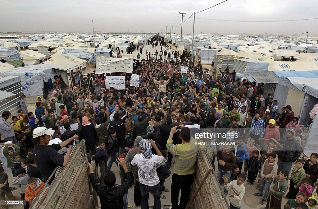 Syrian refugees take part in a demonstration at the Zaatari refugee camp near the border with Syria calling for the international community to arm...