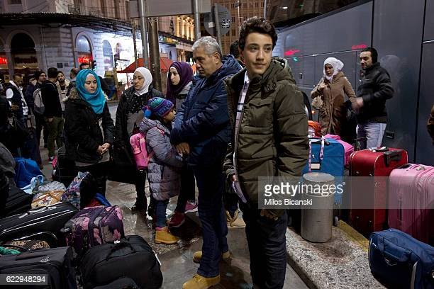 Syrian refugees The Asaaid Alkhateb family wait to board a bus in early morning hours on their way to take a special charter flight for Finland on...