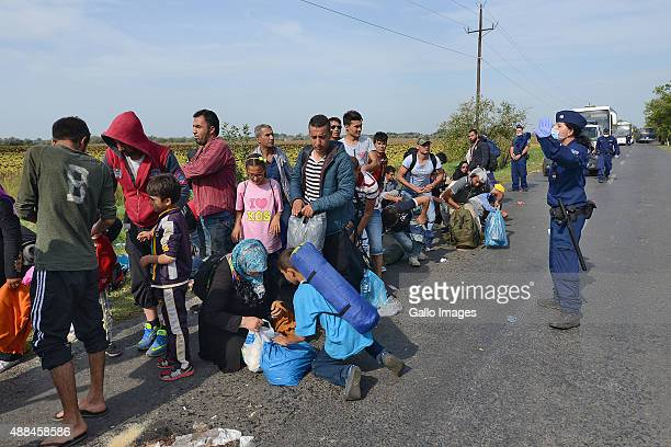 Syrian refugees wait at the HungarianSerbian border in an attempt to enter the European Union on September 15 2015 in Roszke Hungary Hungarian...