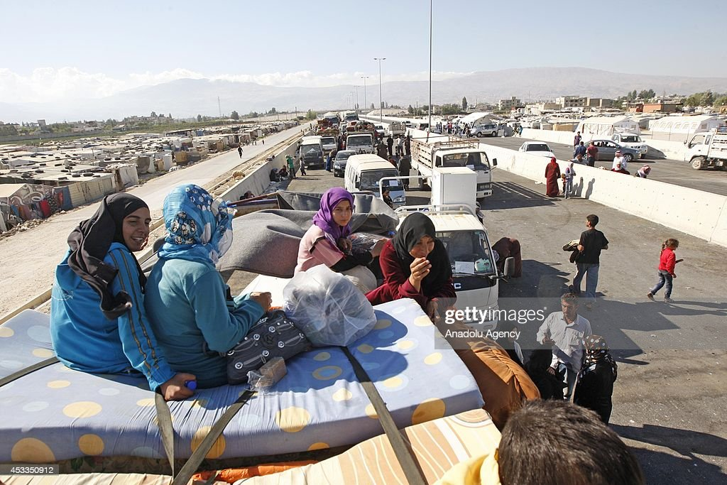 Syrian refugees wait in Arsal of Lebanon a town on the border with wartorn Syria to return Syria in order to flee from clashes between Lebanon army...