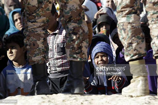 Syrian refugees wait to cross from Syria into Jordan at the Hadalat border crossing east of the Jordanian capital Amman on January 14 2016 The number...