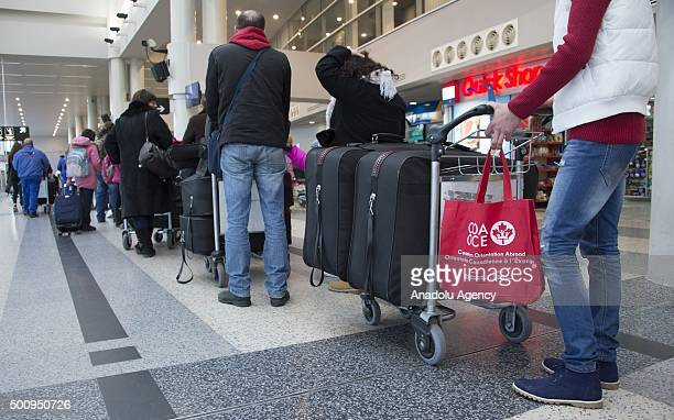 Syrian refugees wait to pass through security at the Beirut International airport as they prepare to depart Lebanon to resettle into Canada in...