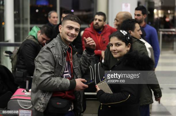Syrian refugees who are a part of a group of Syrians who were granted humanitarian visas by the Italian government gather at the departures hall in...