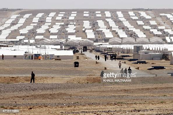 Syrian refugees who fled the deadly conflict in their country walk at Azraq refugee camp on April 28 2015 in Jordan some 100 kilometres east of Amman...