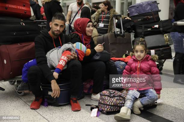 Syrian refugees who were granted humanitarian visas by the Italian government gather at the departures hall in Beirut's International airport on...