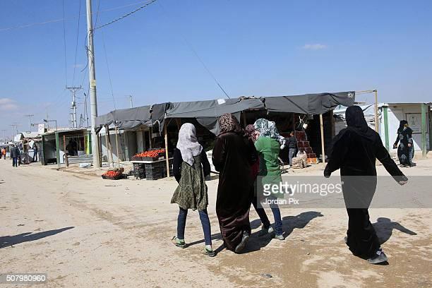 Syrian refugees women walk in a street on February 2 2016 in the Zaatari camp in northeast Jordan King Abdullah of Jordan has said the huge influx of...