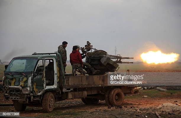 Syrian regime forces fire towards Islamic State jihadists south of the town of AlBab in the northern province of Aleppo on January 14 2016 Backed by...
