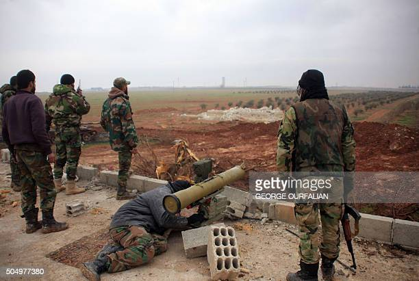 Syrian regime forces take aim at Islamic State jihadists south of the town of AlBab in the northern province of Aleppo on January 14 2016 Backed by...