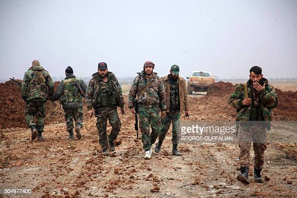 Syrian regime forces walk in an area south of the town of AlBab in the northern province of Aleppo on January 14 2016 Backed by intense Russian air...