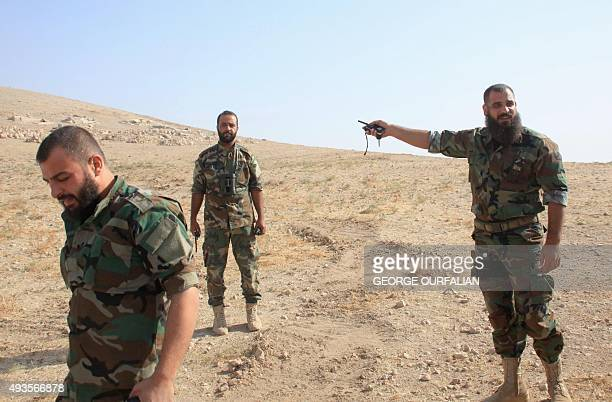 Syrian regime soldiers are seen in the eastern outskirts of the northern Syrian city of Aleppo on October 21 2015 Syrian government forces began a...