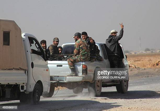 Syrian regime soldiers drive in a pickup truck on the eastern outskirts of the northern Syrian city of Aleppo on October 21 2015 Syrian government...