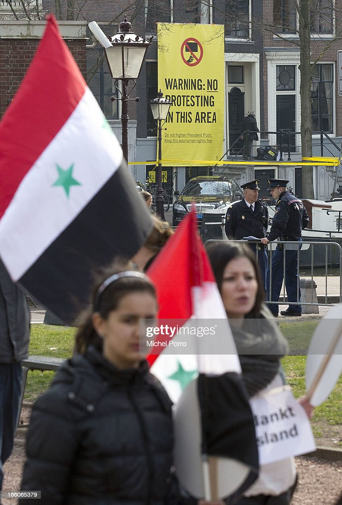 . Syrian residents thanks Russia fo their support as President Putin meets Queen Beatrix of The Netherlands at Tsar Peter Exhibition on April 8, 2013 in Amsterdam, Netherlands. Putin began a one-day state visit to the Netherlands at the invitation of Queen Beatrix.