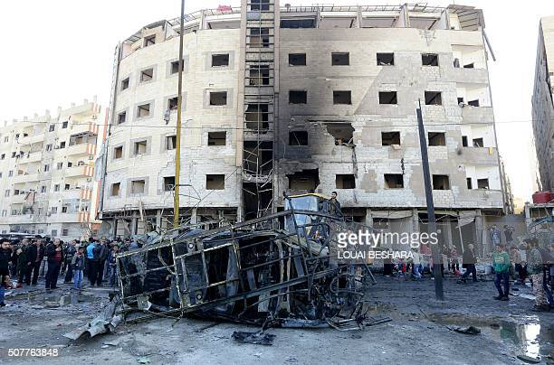 TOPSHOT Syrian security forces and residents gather at the site of suicide bombings in the area of a revered Shiite shrine in the town of Sayyida...