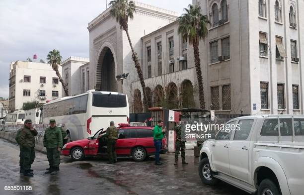 Syrian security forces cordon off the area following a reported suicide bombing at the old palace of justice building in Damascus on March 15 2017 A...