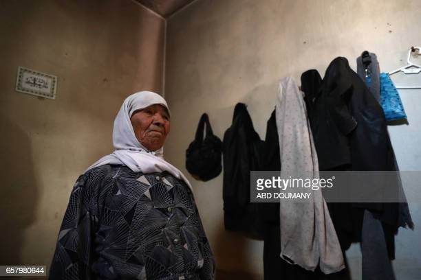 Syrian Sheikha a seventyfiveyear old widow who was displaced from the alAtiba area due to the ongoing fighting sits inside her home in the...
