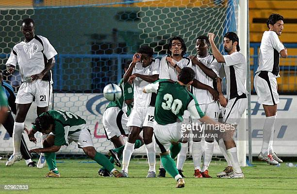 Syrian soccer star Firas alKhatib of Qatari AlAhli club shoots the ball at AlSadd club goal during their semi final match at Qatar's Emir Cup in Doha...