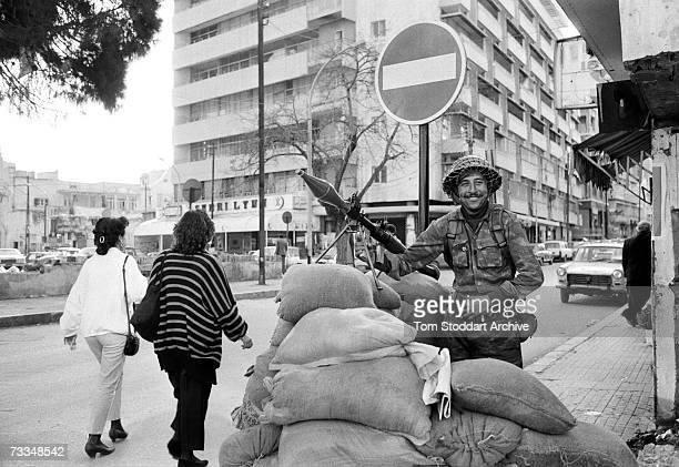 A Syrian soldier with a rocketpowered grenade launcher stands guard in a Beirut city street June 1987 The soldier was one of a deployment of an...