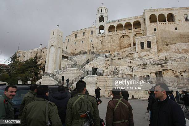 Syrian soldiers accompany journalist on a guided government tour of the Sednaya Monastery to view damage caused to the convent during a recent...