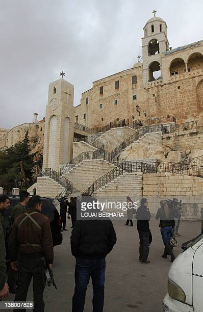 Syrian soldiers accompany journalists on a guided government tour of the Sednaya Monastery to view damage caused to the convent during a recent...