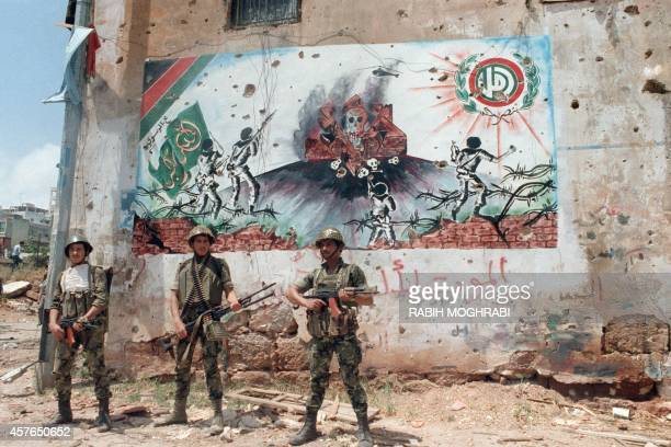 Syrian soldiers patrol in a southern suburb of Beirut 27 May 1988 in front of an Amal frescoes after heavy interShi'ite clashes erupted between...