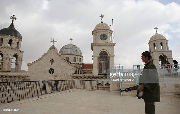 Syrian soldiers stands on the roof of the Sednaya Monastery northwest of Damascus during a guided government tour to show journalists damage caused...