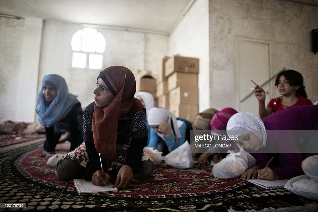 Syrian students attend classes at an improvised school in the town of Azaz, on the border with Turkey, on September 17, 2012. Over 2,000 Syrian schools have been damaged or destroyed and hundreds more are being used as shelters, the UN said on September 14, warning it faced a staggering challenge for the new school year.
