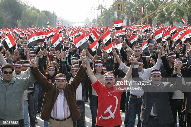 Syrian students demonstrate holding up national flags against mounting international pressure on Syria over its alleged involvement in the murder of...