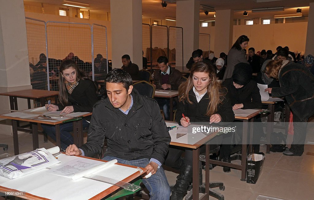 Syrian students from the University of Aleppo sit their exams on January 29, 2013 after the institution re-opened following an explosion earlier in the month, in northern Syria's city of Aleppo. The Britain-based Syrian Observatory for Human Rights confirmed the blast on January 15, which caused a number of causalities, but said its origin was unclear. AFP PHOTO / STR