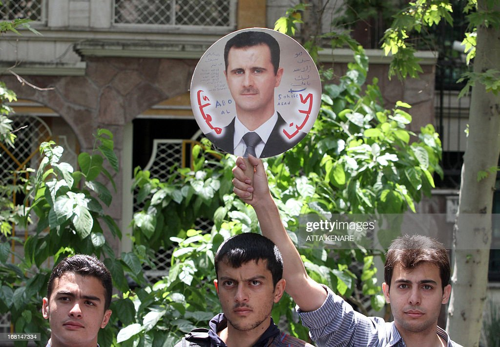 Syrian students, one holding up an image of Syrian President Bashar al-Assad, attend an anti-Israeli demonstration in front of the United Nations offices in Tehran, on May 6,2013, to condemn Israeli air strikes on targets near the Syrian capital Damascus. Israeli raids on Syrian targets at the weekend killed at least 15 soldiers, a watchdog said, as UN chief Ban Ki-moon led calls for restraint to prevent the war spilling over borders.
