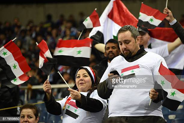 Syrian supporters wave national flags prior to the FIFA World Cup Russia Asian Qualifier second round match between Japan and Syria at the Saitama...