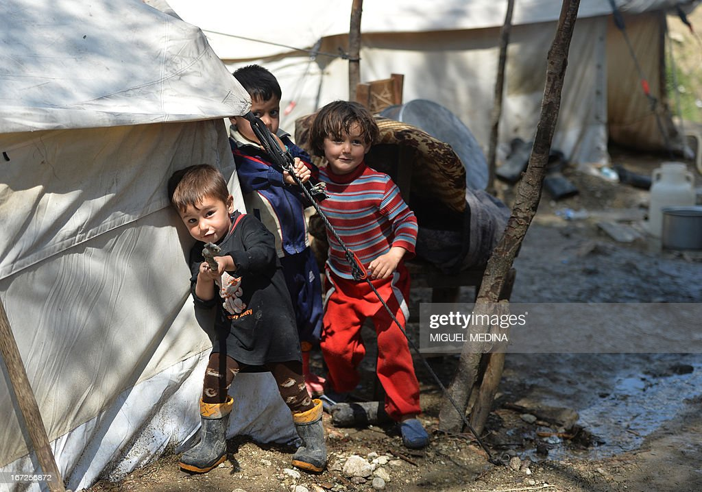 Syrian Turkmen children are seen at a make-shift refugee camp some kilometers away from the Syria-Turkey border on April 23, 2013. There are an estimated four million people displaced inside Syria and 1.2 million refugees in neighbouring countries. AFP PHOTO / MIGUEL MEDINA