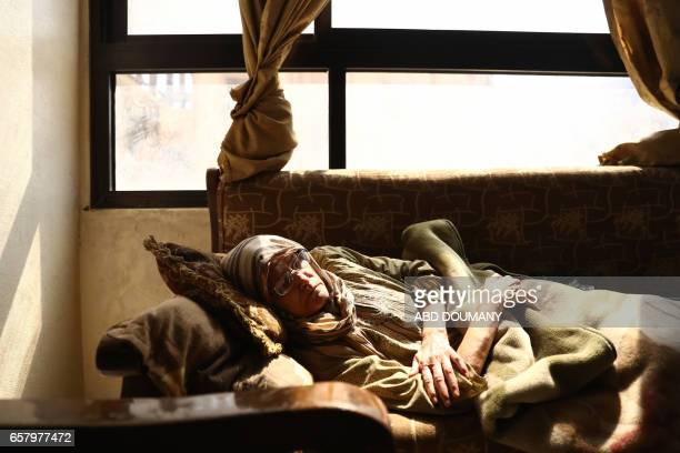 Syrian Umm Ahmad a seventythreeyear old widow who was displaced from the alMaliha area due to the ongoing fighting is seen inside her home in the...