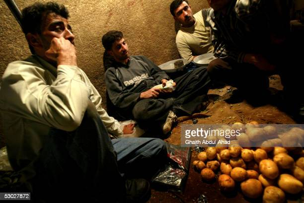 Syrian vegetable vendors wait for late night shoppers on May 25 2005 in the old streets of Damascus Syria Syrian President Bashar alAssad has vowed...