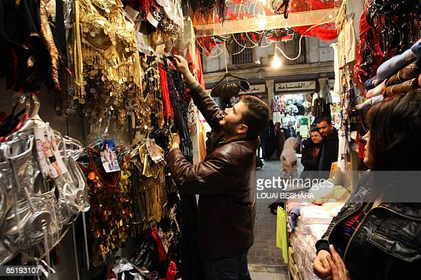 Syrian vendor arranges belly dancing costumes at his shop in Damascus on February 26 2009 Chocolate Strings knickers decorated with singing canaries...