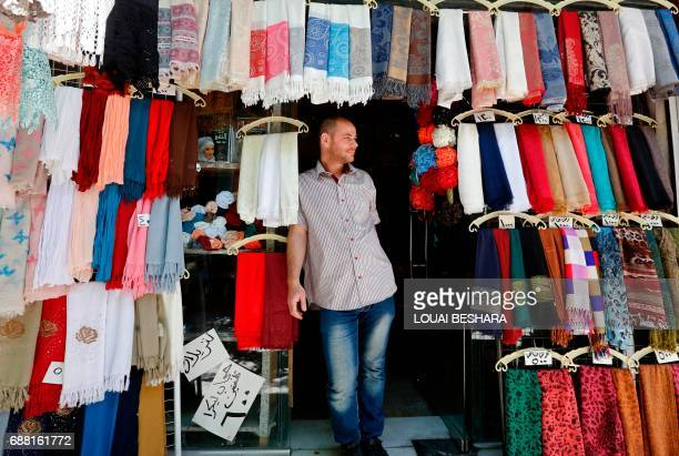 A Syrian vendor stands at the entrance of this shop in the old city of Damascus on May 25 ahead of the start of the Muslim holy fasting month of...