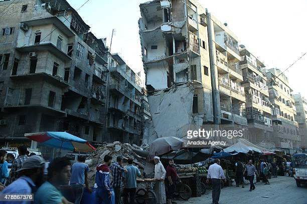 Syrian vendors sell desserts and foods on stands during the holy month of Ramadan in a historical bazaar which is heavily damaged by Asad regime...