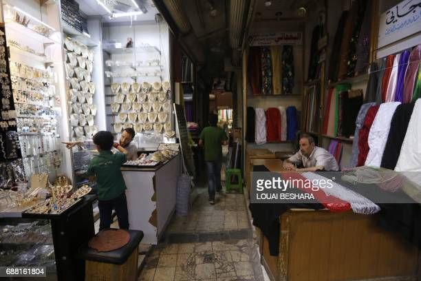 Syrian vendors wait for customers in the old city of Damascus on May 25 ahead of the start of the Muslim holy fasting month of Ramadan / AFP PHOTO /...