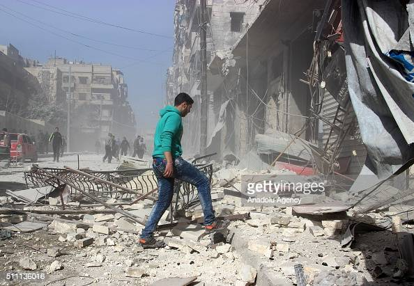 Syrian walks past the rubbles of damaged buildings after the Russian airstrikes targeted residential areas in opposition controlled alFirdaus...