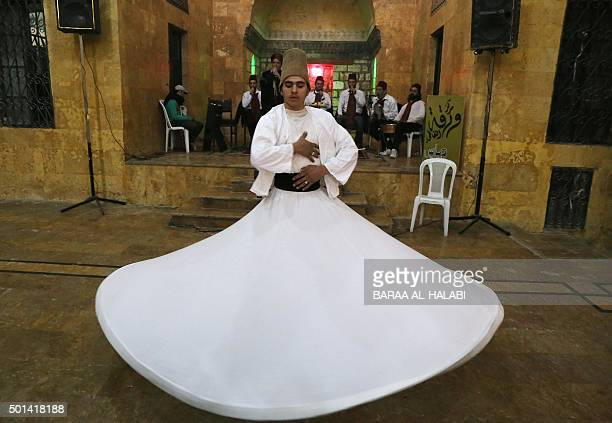 Syrian whirling dervish performs during a ceremony commemorating the death of 13thcentury Sufi poet Rumi on December 14 2015 in Bab alMaqam a...