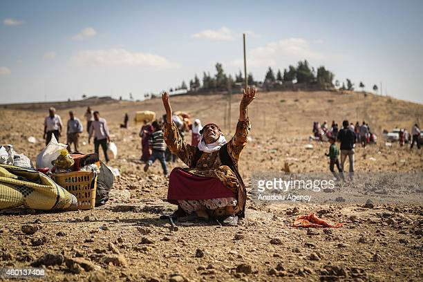 Syrian woman fled from clashes between the Islamic State of Iraq and Levant militants and Democratic Union Party forces in the ArRaqqah Governorate...