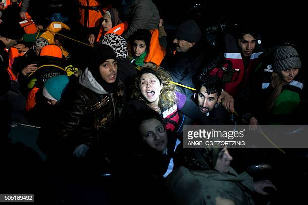 Syrian woman reacts as refugees and migrants aboard an inflatable dinghy are about to be rescued by MOAS while attempting to reach the Greek island...