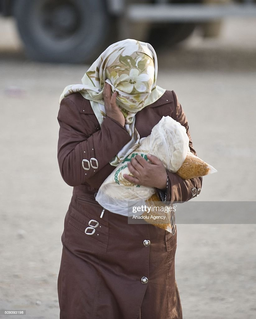 A Syrian woman, who fled bombing in Aleppo, is seen after she received food at a tent city close to the Bab al-Salam border crossing on Turkish-Syrian border near Azaz town of Aleppo, Syria on February 10, 2016. Russian airstrikes have recently forced some 40,000 people to flee their homes in Syrias northern city of Aleppo.