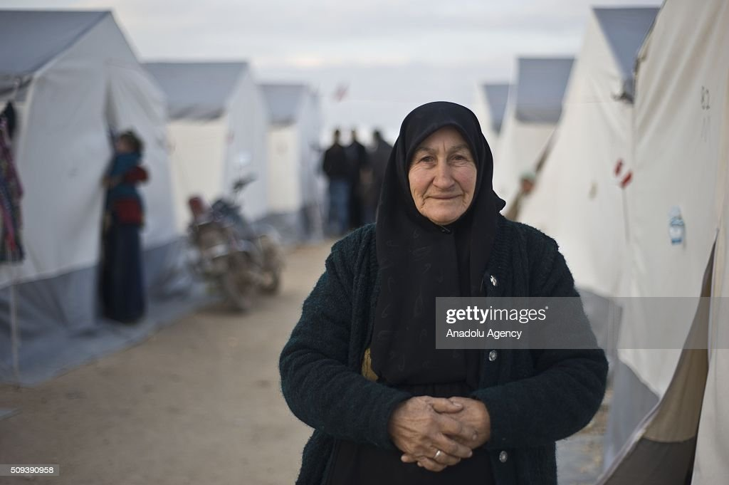 A Syrian woman, who fled bombing in Aleppo, is seen at a tent city and close to the Bab al-Salam border crossing on Turkish-Syrian border near Azaz town of Aleppo, Syria on February 10, 2016. Russian airstrikes have recently forced some 40,000 people to flee their homes in Syrias northern city of Aleppo.