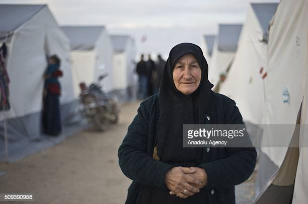 Syrian woman who fled bombing in Aleppo is seen at a tent city and close to the Bab alSalam border crossing on TurkishSyrian border near Azaz town of...