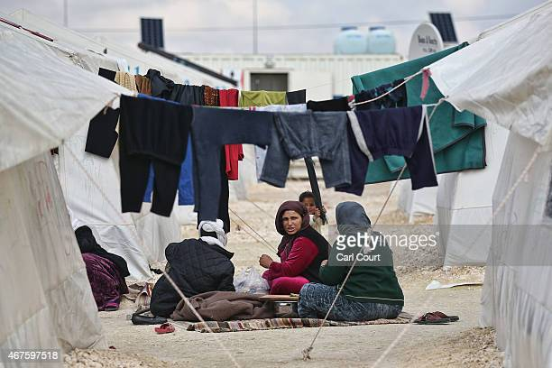 Syrian women chat in Suruc refugee camp on March 25 2015 in Suruc Turkey The camp is the largest of its kind in Turkey with a population of around...