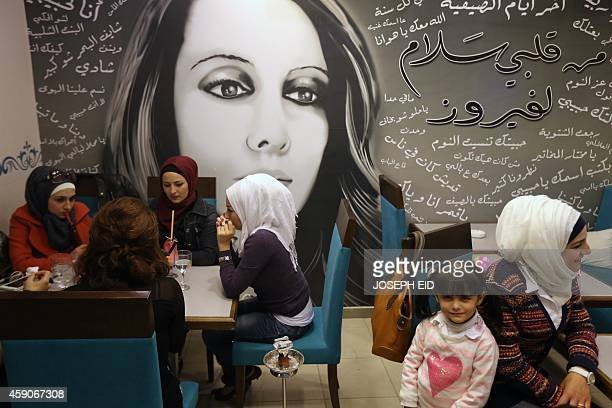 Syrian women dine in the Fairuz restaurant in the governmentcontrolled Mogambo neighourhood of the northern city of Aleppo on November 15 2014 AFP...