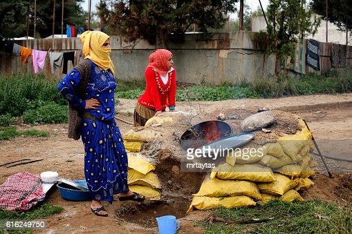 Syrian women making bread : Stock Photo